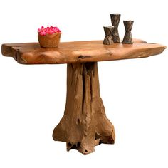 Add an organic touch to you living room or foyer with this reclaimed teak wood console table. Artfully crafted with a freeform silhouette, this rustic-chic d...