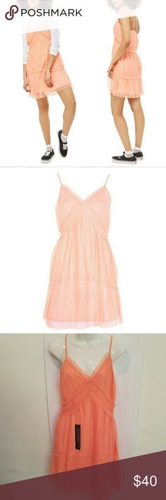 "Topshop Layered Tulle Slipdress 6 NWT Topshop Layered Tulle Slipdress size 6 NWT. Coral peach, layered, pleated Tulle slipdress. Sleeveless, strappy style, side zip. V neck, adjustable straps. Fully lined. 100% polyester. Approx. measurements Length 35"", armpit to armpit 15.5"". Topshop Dresses"