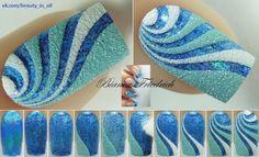 Blue swirling nail art