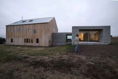 The classic barn form of the Sebastopol Barn House is the result of a historic timber frame structure dismantled in upstate New York, cleaned, cataloged, and...