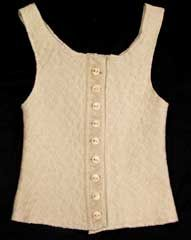 ….crikey, I hated wearing these things when I was small. A liberty bodice was statutory winter uniform in our house…over a vest I might add!