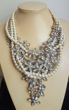 Check out this item in my Etsy shop https://www.etsy.com/ca/listing/541304375/chunky-pearl-and-rhinestone-statement