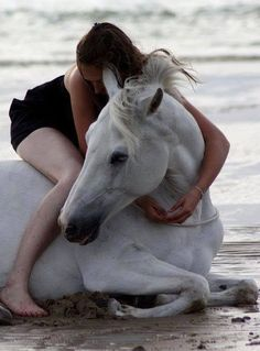 This a picture of perfect happiness.  Hugs, sand, and horse...  It's just...wonderful!! <3