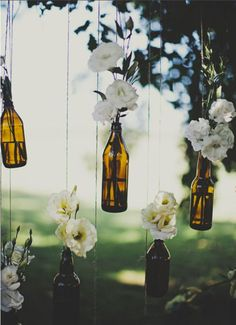 with different colored bottles! this would be so cute for an apartment porch!