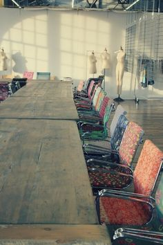 // conference room... Chairs all have different patterns/prints + mannequins