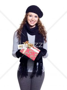 trendy young woman displaying her christmas present. - Portrait of a trendy young woman displaying her Christmas present over white background, Model: Brittany Beaudoin