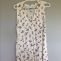 Maternity Old Navy large tunic top Super cute maternity top from Old Navy. Navy bird pattern on off-white background. Can tie in front or back. Good condition. Bundle 3 items from my closet and save 15%! Old Navy Tops Tunics