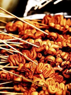 Chicken intestines on a stick is a common street vendor food in the Philippines