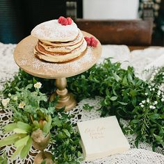 Love the stand and the lace and a little bit of greenery!!