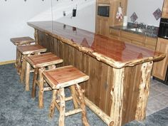 "Eastern Red Cedar ""wrap around"" Log Bar with Black Ash t&g, log corners. Matching Bar Stools w/ swivels."