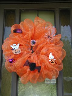 """Halloween Deco Mesh Wreath - This is my first - they are fun and very easy  Supplies needed: 16"""" straw wreath, 1 roll deco mesh, approximately 60 metal fern pins, your choice of decorations and orange pipe cleaners to attach decorations or glue gun to glue them on. I used pipe cleaners so I can change the decorations to fall silk flowers and use for a """"Fall Wreath"""". Have Fun!!"""