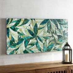 As a symbol of nature, the color green is said to have a calming, optimistic effect on our mood. Pick the perfect spot to hang our handcrafted wall panel and gaze at a mosaic of glass-tile leaves in verdant tones of olive, hunter, emerald and more. You\'ll experience a sense of serenity welcome in any home.