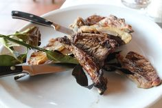 Locally produced grilled meats at Le Fontanelle seasoned with a bay leaf branch