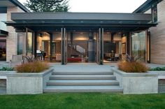 Architecture Minimalist Exterior Of The Washington Park Hilltop Residence With Concrete Terrace And Wide Pergola Near Grass Yard Remarkable Contemporary Home Design Using Modern Lighting Installation Contemporary Patio, House, Modern House Design, Modern House, House Exterior, Lake House, Exterior Design, Contemporary House, Modern House Exterior
