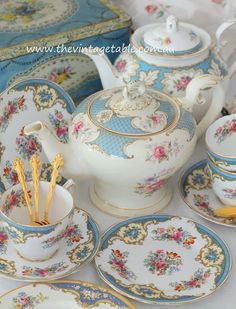 Beautiful blue vintage bone china tea sets and gold plated cutlery.
