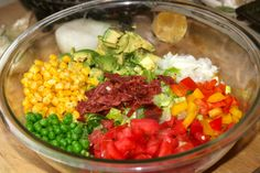 Loaded Veggie Salad w/ onion, tomato, red & yellow bell pepper, corn, peas, avocado, turkey bacon, and chicken!