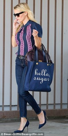 Style icon: The Oscar-winning actress, who can be seen carrying a 'Hello, Sugar' tote from her Draper James collection (pictured), was recently named as People magazine's best-dressed person of 2015