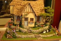 cottage feel and great landscaping, turns out it is by Suzanne Andrew's minis