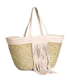 Bring a touch of this season's trendy fringe to the beach with this braided straw bag with suede details. | H&M Pastels