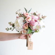 We're all a bit in love with this beautiful bridal bouquet...the perfect mix of soft, feminine and rustic!  #artificialflowers #silkflowers #bridal #bridalbouquet #bridesmaids #bride #rose #peonies #eucalyptus #beautiful #pink