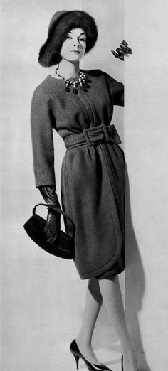 1960 Model in softly gathered wool coatdress in prune, waist is belted in self-same material, by Nina Ricci