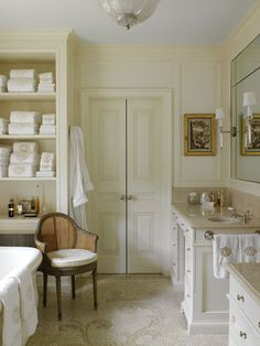 I would make a soft terry cloth cushion cover for a waterproofed pillow seat. Luxury, comfort, and easy to keep clean.  Cane chair in bathroom- Nancy Boszhardt
