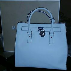 Michael Kors Large White Hamilton 100% Authentic. This bag is a beauty!!!!Absolutely perfect condition. No scratches on leather or hardware. Always kept in dustbag, inside the box. No stains on inside OR outside of purse. I don't smoke so no smells on it. I condition all my bags before use and prior to storage.  Purchased at Michael Kors store in Boca Raton. Originally paid over $400 after taxes. MICHAEL Michael Kors Bags