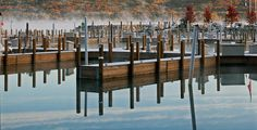 It's autumn when the docks become empty and the leaves in the distance begin to change. Boyne City, Northern Michigan, Empty, Distance, Leaves, Autumn, Change, Photography, Home