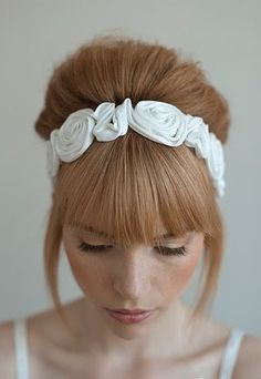 Lush bridal hair with straight bangs