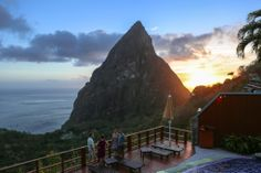 Ladera's pool deck, perched above the Pitons in St. Ladera Resort St Lucia, Go Glamping, Experiential, Mount Everest, Deck, Mountains, Travel Ideas, Sunsets, Outdoors