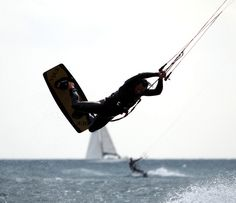 Two #kitesurfers in action over the #sea of #Liguria - #kitesurf at its best, even if the sun was shaded by clouds
