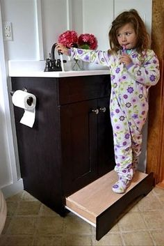 "Install a slide-away ""step"" in your bathroom baseboard to solve your short person problems. 