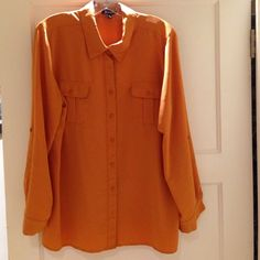 Orange Long Sleeve Button Down Blouse Super comfy orange button down blouse. Sleeves can be worn long or buttoned up to 3/4 long. Has 2 pockets on front top. 100% polyester. Made by Elementz. Gently used. Elementz Tops Button Down Shirts