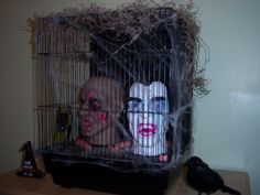 Found a couple of motion activated talking heads at Walgreens so I put them in a cage with moss and spider webs.