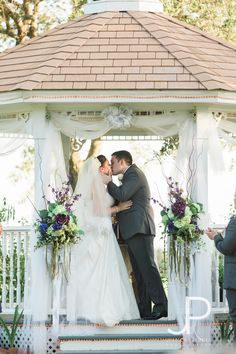 Wedding kiss at an outdoor gazebo wedding in September. Weddings at the gazebo at House Plantation take advantage of the lakes and grounds, using the Great Hall for dining and dancing.