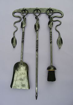 Wall Hanging Leaf Irons Poker....this is beautiful, but I wouldn't use them for their intended purpose beacause I'd be afraid of the wall getting dirty and marked up. I would however leave them hung for decoration.