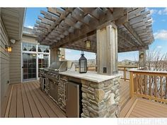 Imagine barbecuing in this amazing outdoor kitchen with stainless steel grill and Pergola ---- 8275 Kelzer Pond Drive, Victoria, MN 55386 —