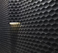 Creative and clever use of light and texture on a wall