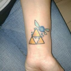 The legend of Zelda tattoo. Navi and the triforce. Gamer Tattoo.
