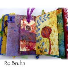 Inside one of Ro Bruhn's Hand made fabric and decorated paper journals. via Etsy.