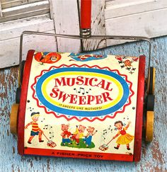 Vintage Fisher price Musical Sweeper Toy Tin Lithos 1950s...Perfect toy to teach little girls their future place in life.