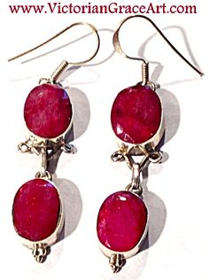 $69 Natural FACETED RUBY EARRINGS,  approx 49cttw .925 STERLING SILVER,  2 3/8 inches long, stones are APPROX 15MM.