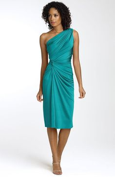 This teal one-shoulder bridesmaids dress that cinches at the waist is a frock your ladies will wear