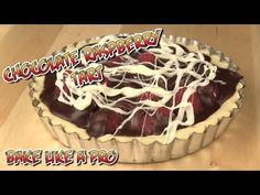 Chocolate Raspberry Tart ! - HD Video Recipe.  - I'll show you how to make a stunning chocolate tart, filled with fresh raspberries and chocolate ganache.  We'll make the ganache too, and use a shortbread tart crust we made in another video.  We fill the tart with raspberries, then I flood the tart with our chocolate ganache, finally I drizzle white chocolate on top for a nice effect.  This is one yummy dessert ! - and... easy to make !