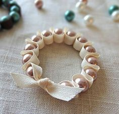 Beachy as Sand or Natural-colored Twill Tape or Textured Ribbon with Shells, Charms & Pearls - DIY Ribbon and Pearl Stretch Bracelet by twinkleandtwine by estelle Armband Tutorial, Bracelet Tutorial, Beads Tutorial, Ornament Tutorial, Ribbon Bracelets, Diy Bracelet, Pearl Bracelets, Stretch Bracelets, Ribbon Choker