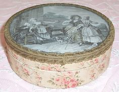 Beautiful early 1900s petite sized storage box covered with French fabric patterned with pink roses
