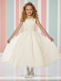 Sleeveless satin and organza tulle tea-length full A-line dress with scoop neckline, satin bodice with side re-embroidered lace motif
