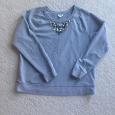 Jewel studded sweatshirt Fun pull over in good condition.  Few very tiny light yellow paint spots on low arm and flank (in pics).  I had to really look for them! Otherwise all very good.  The tag is XL but I believe this is in girls as it fits my teen daughter who is s size 6.  So would fit adult women's small. Old Navy Tops Sweatshirts & Hoodies