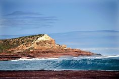 Red Bluff rises above the water in Kalbarri National Park in Western Australia. Oh The Places You'll Go, Cool Places To Visit, Kalbarri National Park, Australian Road Trip, Red Bluff, Australia Travel Guide, Next Holiday, Western Australia, Travel Destinations