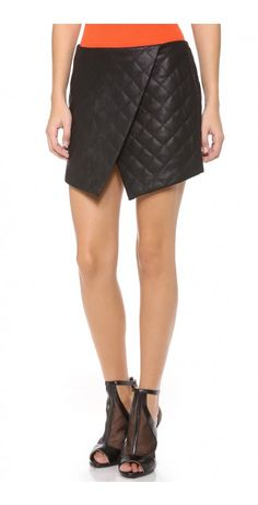 OBLIVION SKIRT - $36.27  A quilted finders KEEPERS miniskirt, rendered in rich faux leather. The wrap-inspired silhouette is cut with an asymmetrical hem. Exposed back zip. Lined.